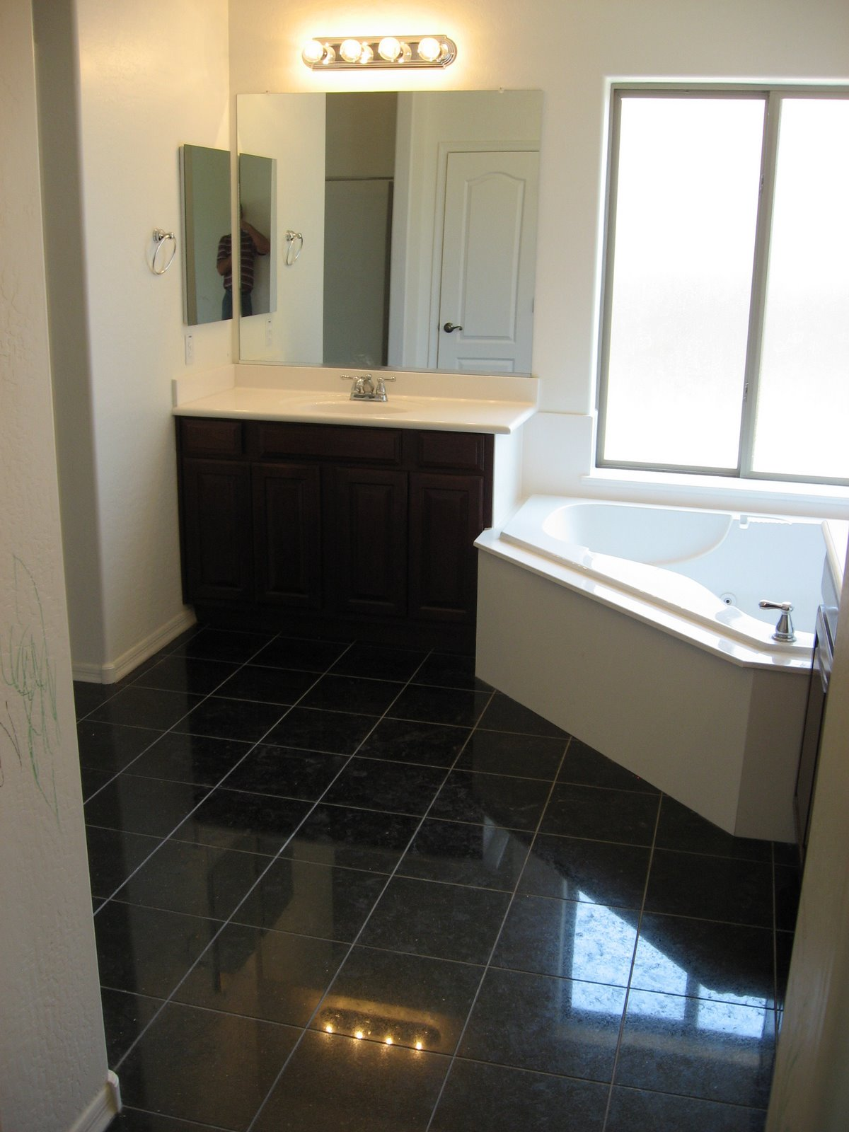 Vitrified tiles granite or marble which is a better option black granite flooring dailygadgetfo Choice Image