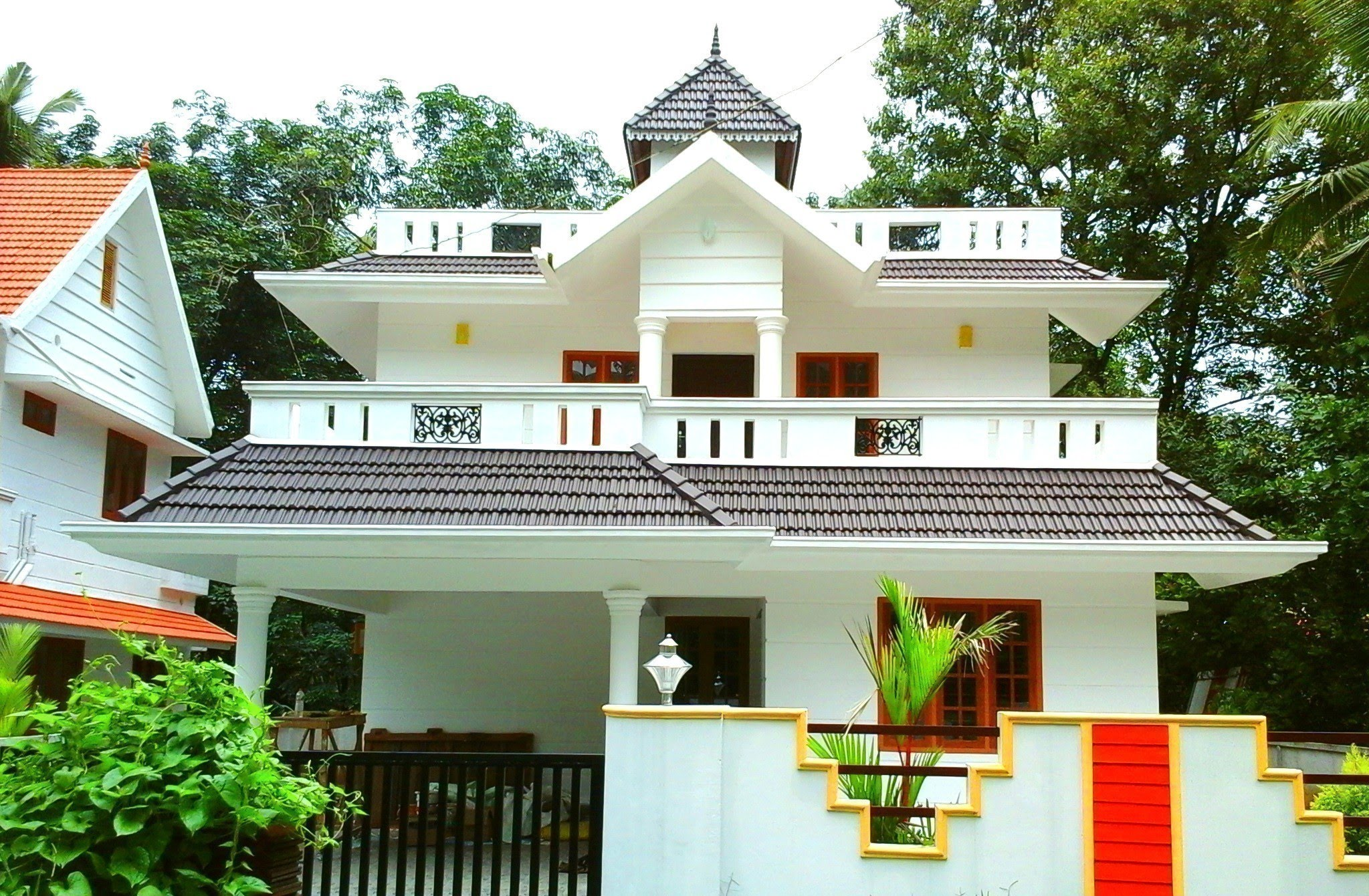 Understanding a traditional kerala styled house design for Sloped roof house plans in india