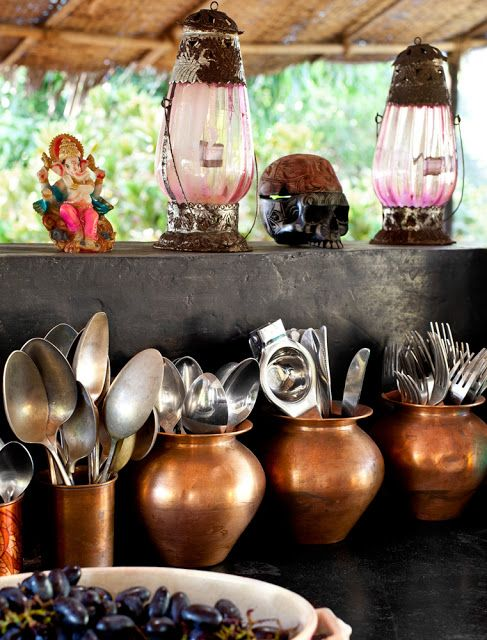 Using copper vessels and latern lights to give a vintage look to kitchen